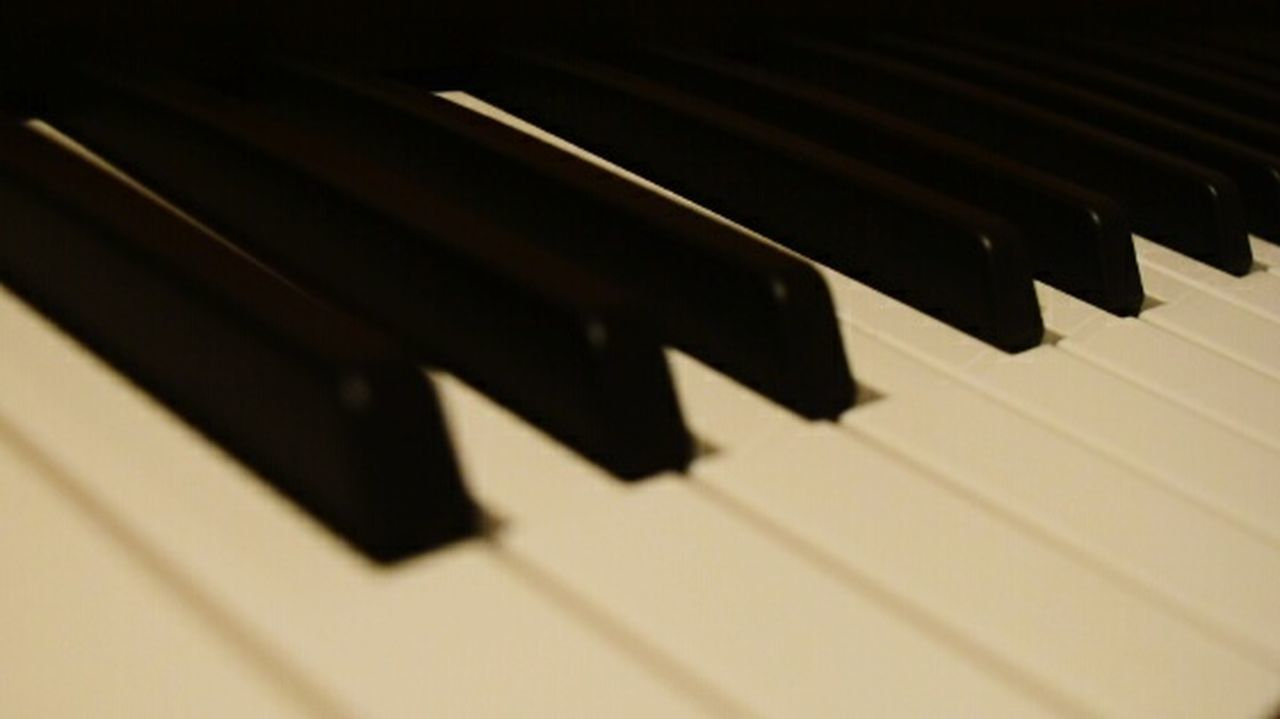 piano, music, piano key, musical instrument, keyboard instrument, arts culture and entertainment, classical music, black color, classical musician, performing arts event, shadow, close-up, no people, playing, pianist, indoors, jazz music, day