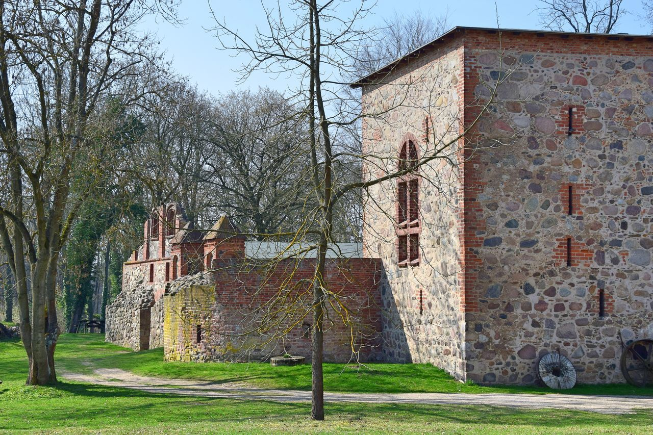 Architecture Bare Tree Brick Building Building Exterior Built Structure Day Fieldstone Grass Green Color Historic Historical Building Moated Castle Nature No People Old Old Buildings Outdoors Sky Tree Wasserburg Gerswalde