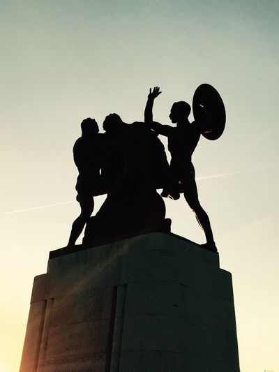 Statue Human Representation Sculpture Low Angle View Male Likeness Art And Craft Silhouette Clear Sky Outdoors Sky No People Day King - Royal Person Razionalismo Secondorinascimento Fascism Architecture Ventennio Fascistarchitecture Utopia Photo Fascism Architecture Sunset EyeEmNewHere