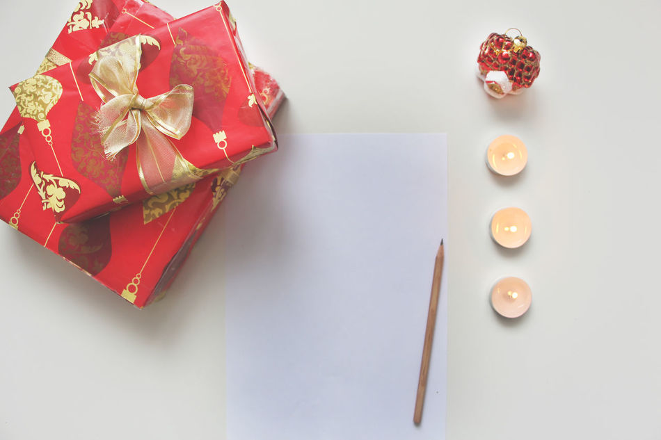 Candle Candlelight Celebration Christmas Christmas Lights Christmas Preparations Dream List Gift Happy New Year Indoors  List Of Desires New Year No People Pencil Present Red And White White Background Writting