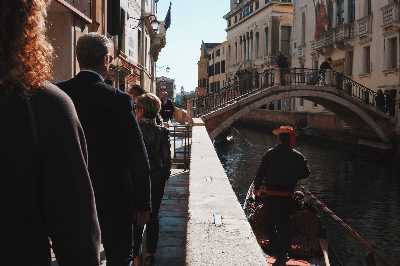 architecture, built structure, building exterior, city, men, real people, outdoors, day, women, togetherness, gondola - traditional boat, adult, people, adults only