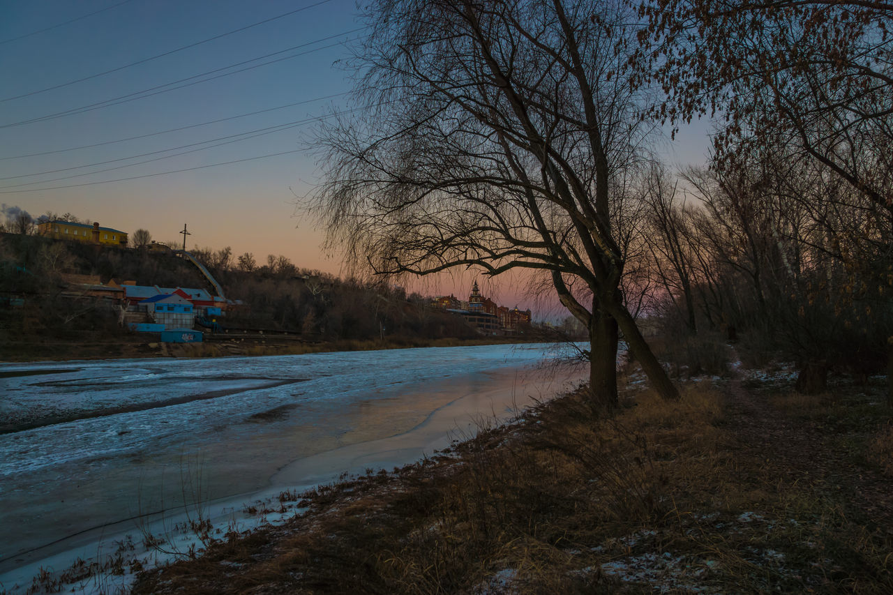 Sunset Water Reflection Tree Sky Nature No People River River Ural Outdoors Beauty In Nature Close-up Tranquil Scene Ice Winter Wet Tranquility Travel Destinations Lights And Shadows Evening Urban Landscape Architecture Multi Colored Cityscape Illuminated