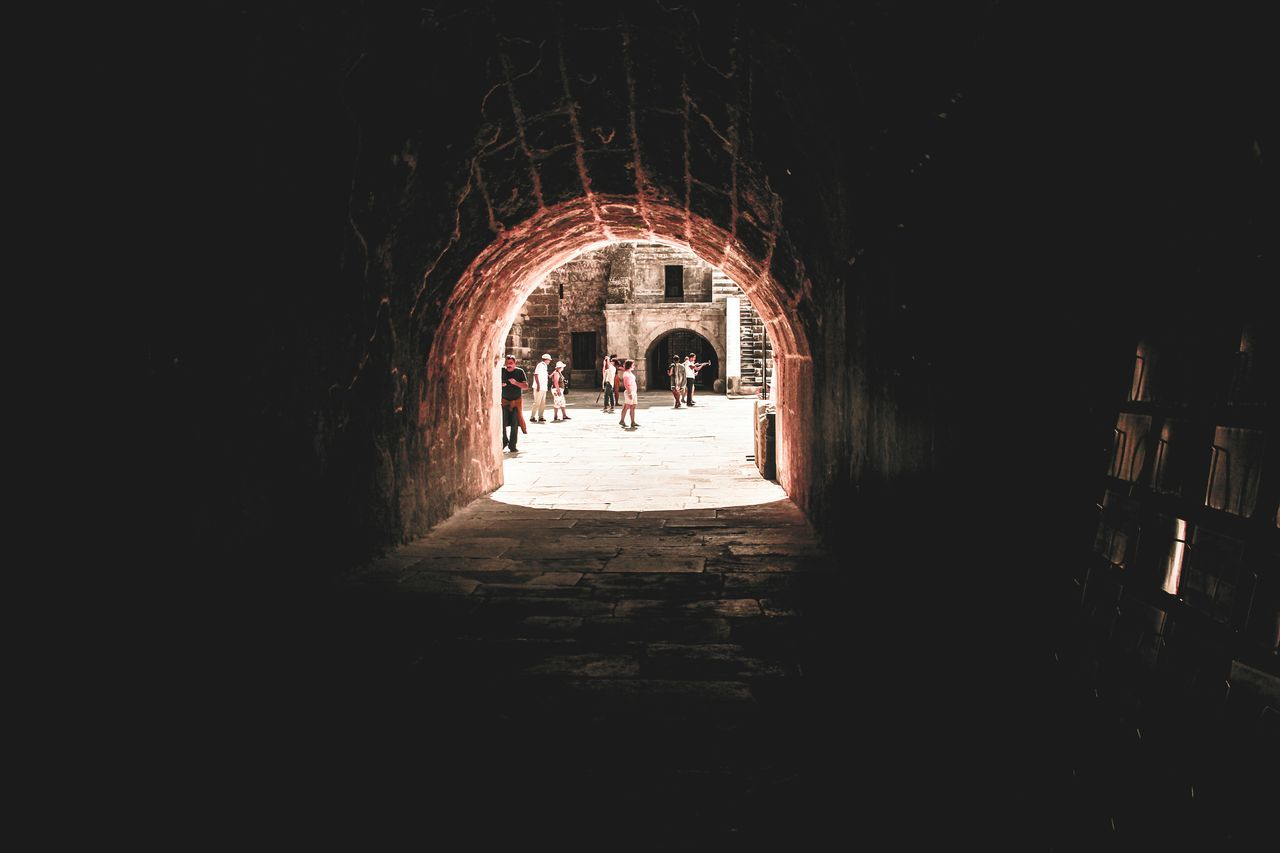 arch, built structure, the way forward, architecture, real people, indoors, tunnel, lifestyles, day, men, full length, illuminated, one person, people
