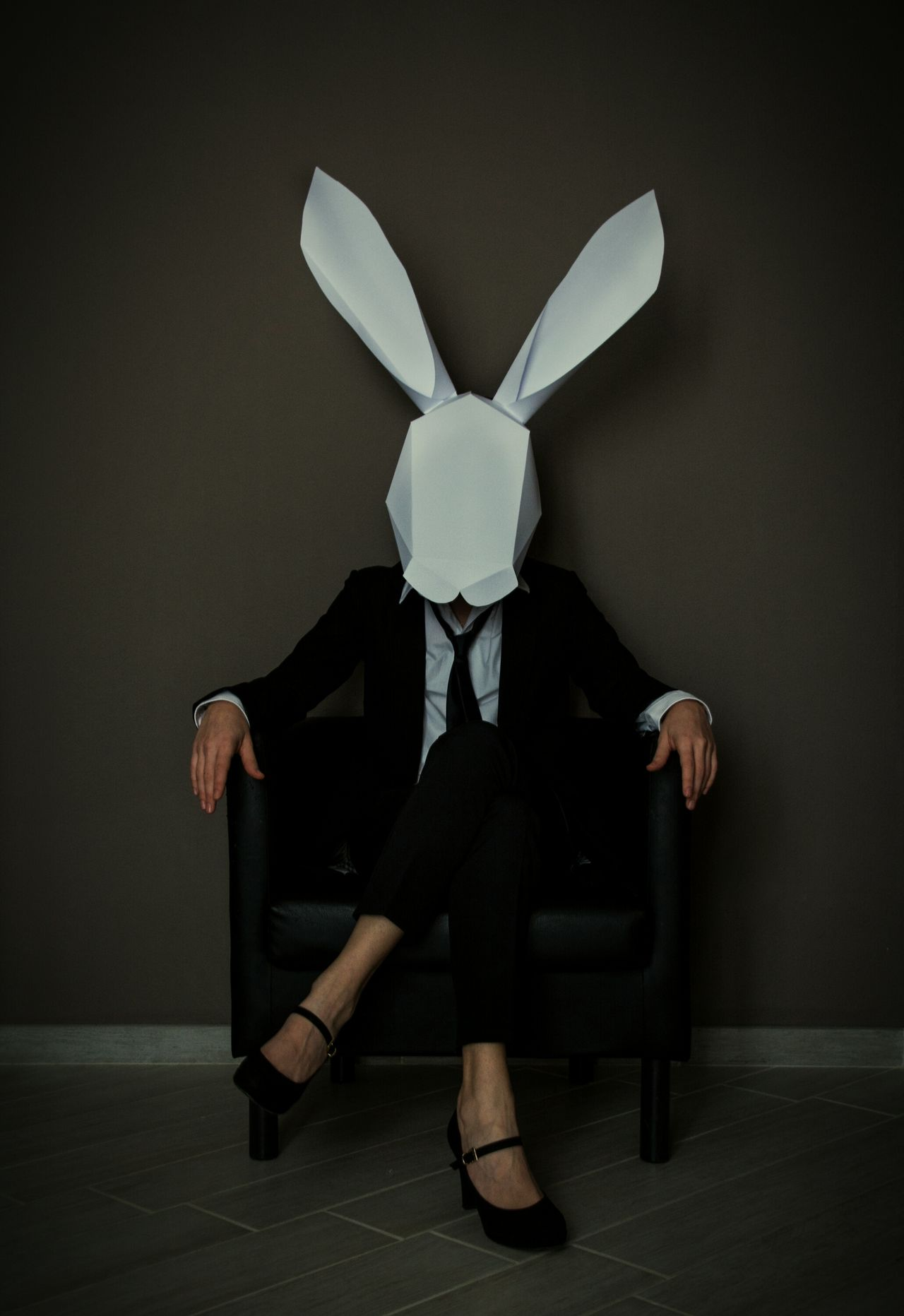 Well-dressed One Person Moody Mask Rabbit Faceless Portrait Faceless Young Woman Sitting Dark Photography Conceptual Photography  Paper Mask Suit & Tie Heels Dark Portrait Surreal