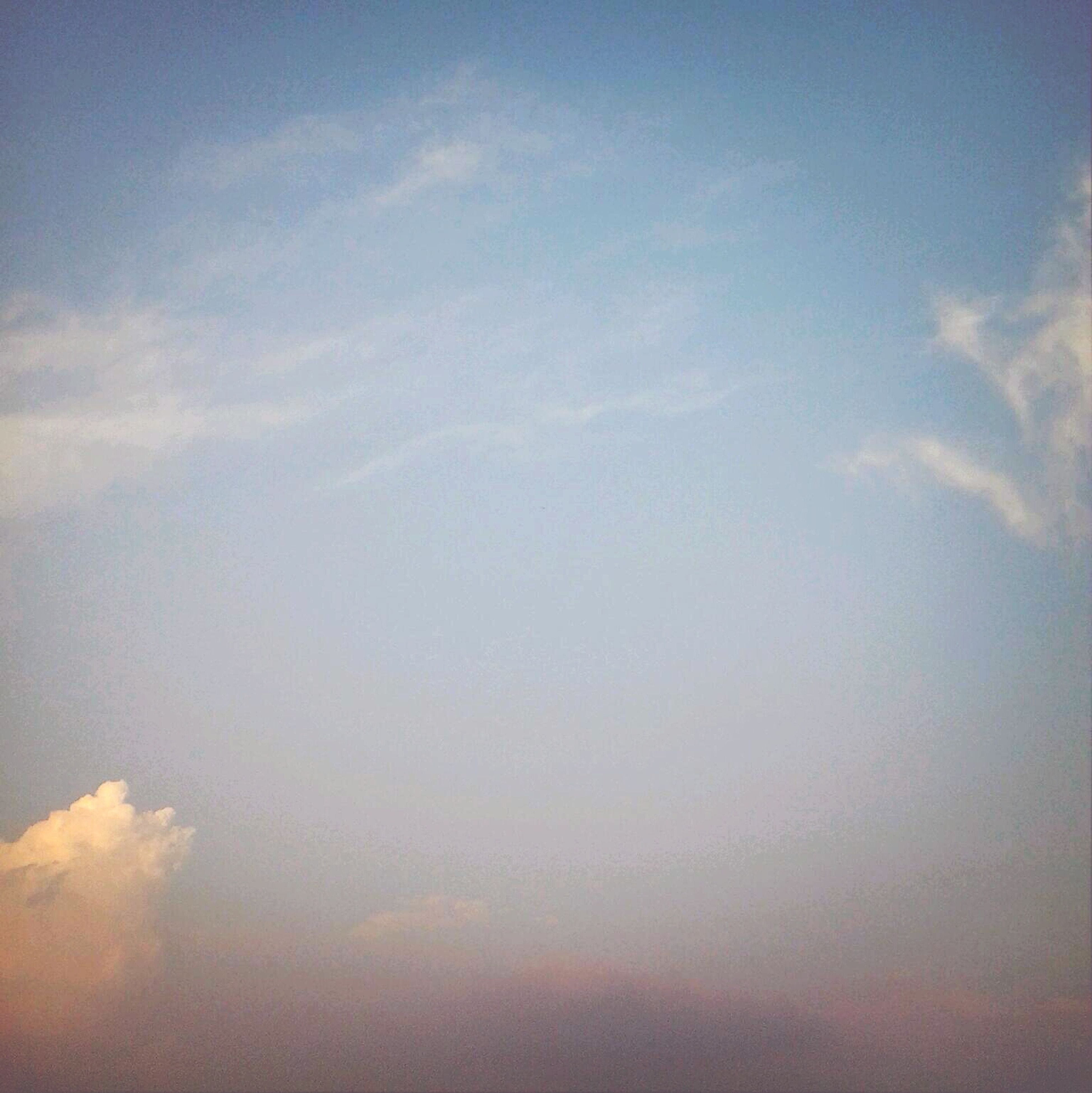 sky, tranquility, scenics, tranquil scene, beauty in nature, cloud - sky, nature, low angle view, idyllic, cloud, blue, cloudy, sky only, outdoors, no people, cloudscape, backgrounds, sunset, day, majestic