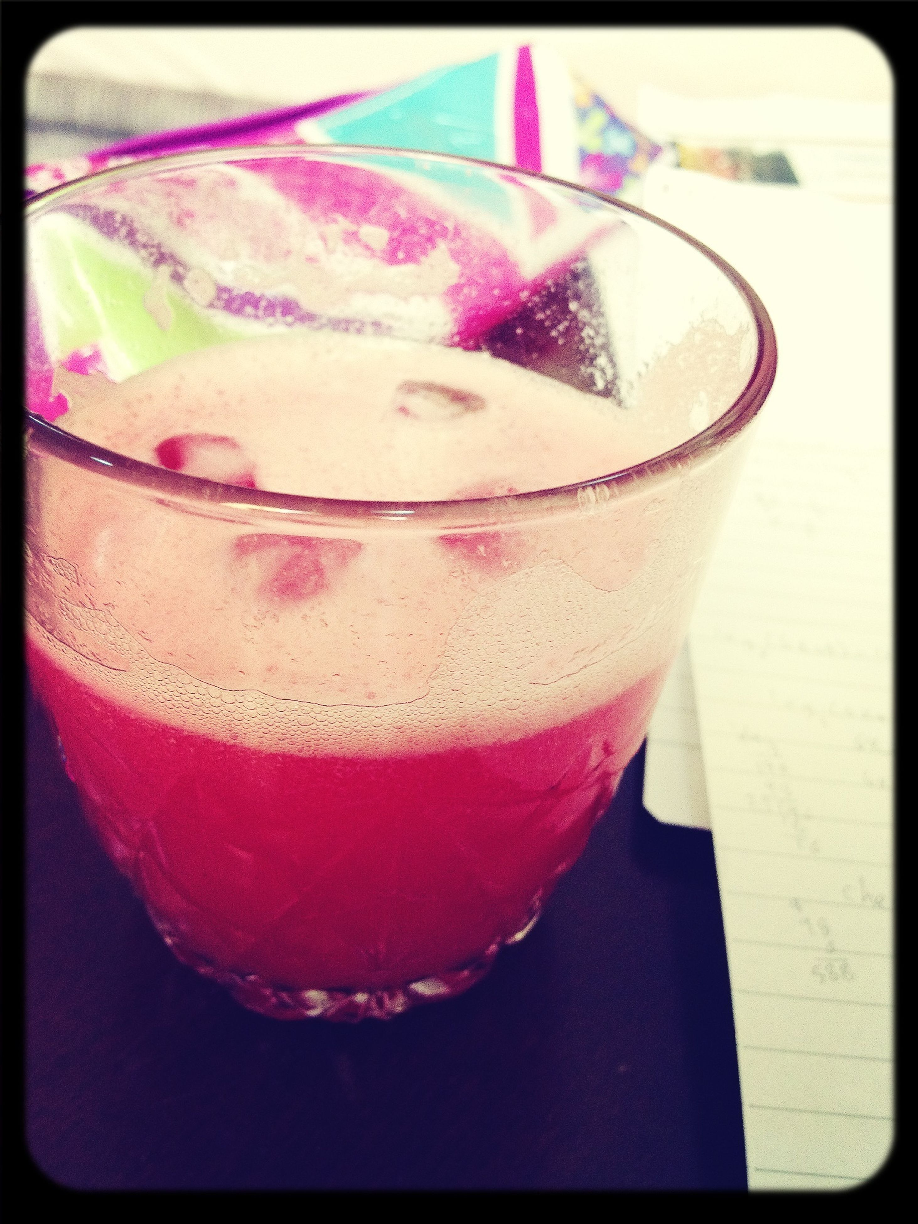 drink, food and drink, transfer print, freshness, refreshment, drinking glass, indoors, table, auto post production filter, still life, close-up, pink color, sweet food, drinking straw, glass - material, dessert, high angle view, indulgence, cocktail, red