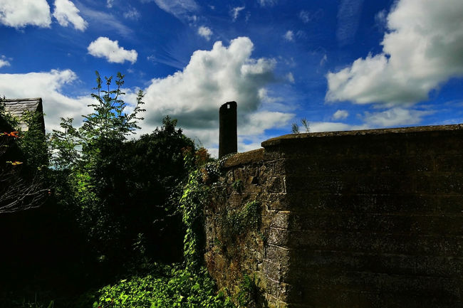 Ancient Round Tower, Clones, Co. Monaghan, Ireland. Ancient Structure Architecture Blue Built Structure Cloud Cloud - Sky Cloudy Day Deterioration Grass Green Color Growth Landscape Low Angle View Nature No People Outdoors Plant Round Tower Sky Tranquility