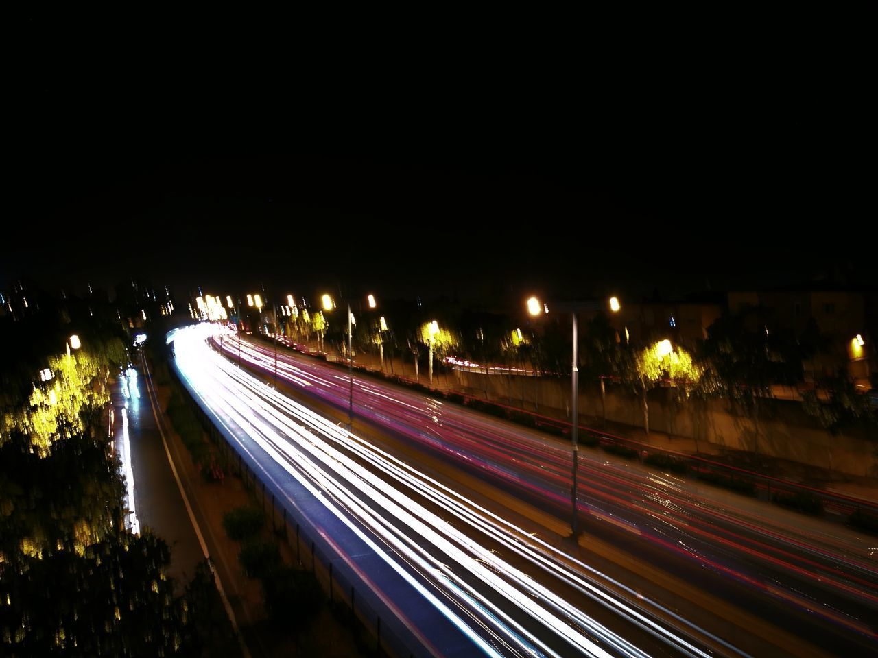 illuminated, night, speed, light trail, long exposure, motion, blurred motion, high street, transportation, high angle view, no people, outdoors, city, street light, road, architecture