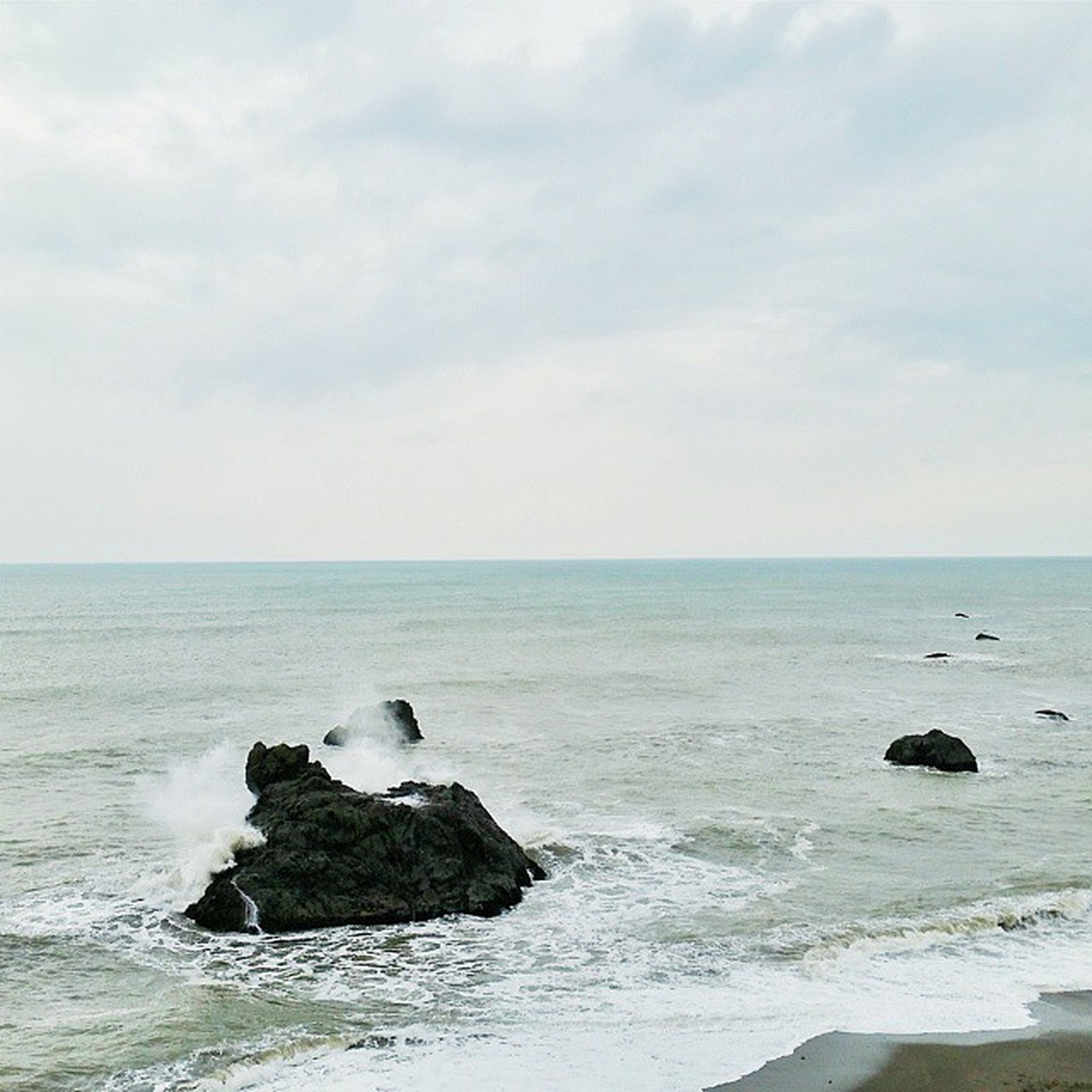 sea, horizon over water, water, scenics, sky, beauty in nature, rock - object, tranquil scene, tranquility, wave, nature, beach, shore, idyllic, cloud - sky, rock formation, rock, surf, seascape, remote