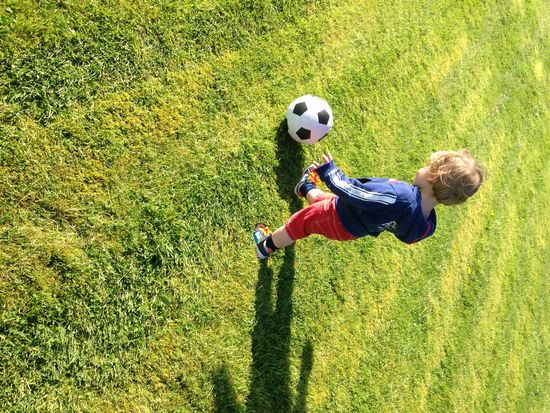 Abundance Balance Ball Carefree Challenge Childhood Close Up Day EyeEm Gallery Field Full Length Grass Green Color Innocence Learning Leisure Activity Lifestyles One Person Outdoors Playing Shadows & Lights Soccer Sport Toddler  Vignette