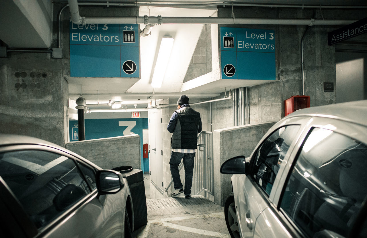 The level of our lives. There's no way to happiness, happiness is the way. Aqua Back Turned Cold Elevators Guidance Levels Moody Parked Cars Parking Lot Perspective Powerful Sad Symmetry Vest Walking Winter