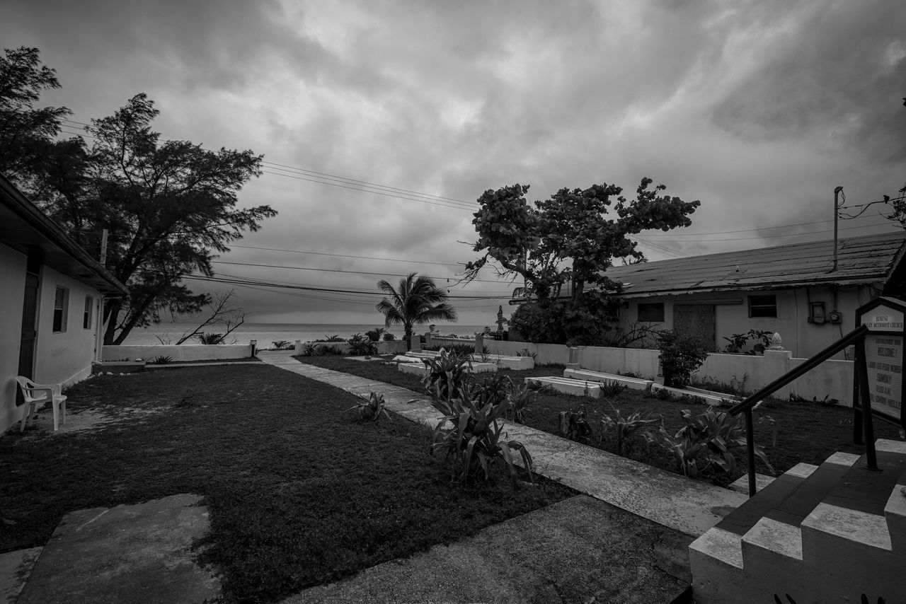 Old Cemetery Architecture Bimini Blackandwhite Photography Building Exterior Built Structure Caribbean Cemetery Cloud - Sky Day House Nature No People Ocean View Old Buildings Outdoors Photographyisthemuse Rustic Sky Small Town Storm Clouds The Bahamas Tree