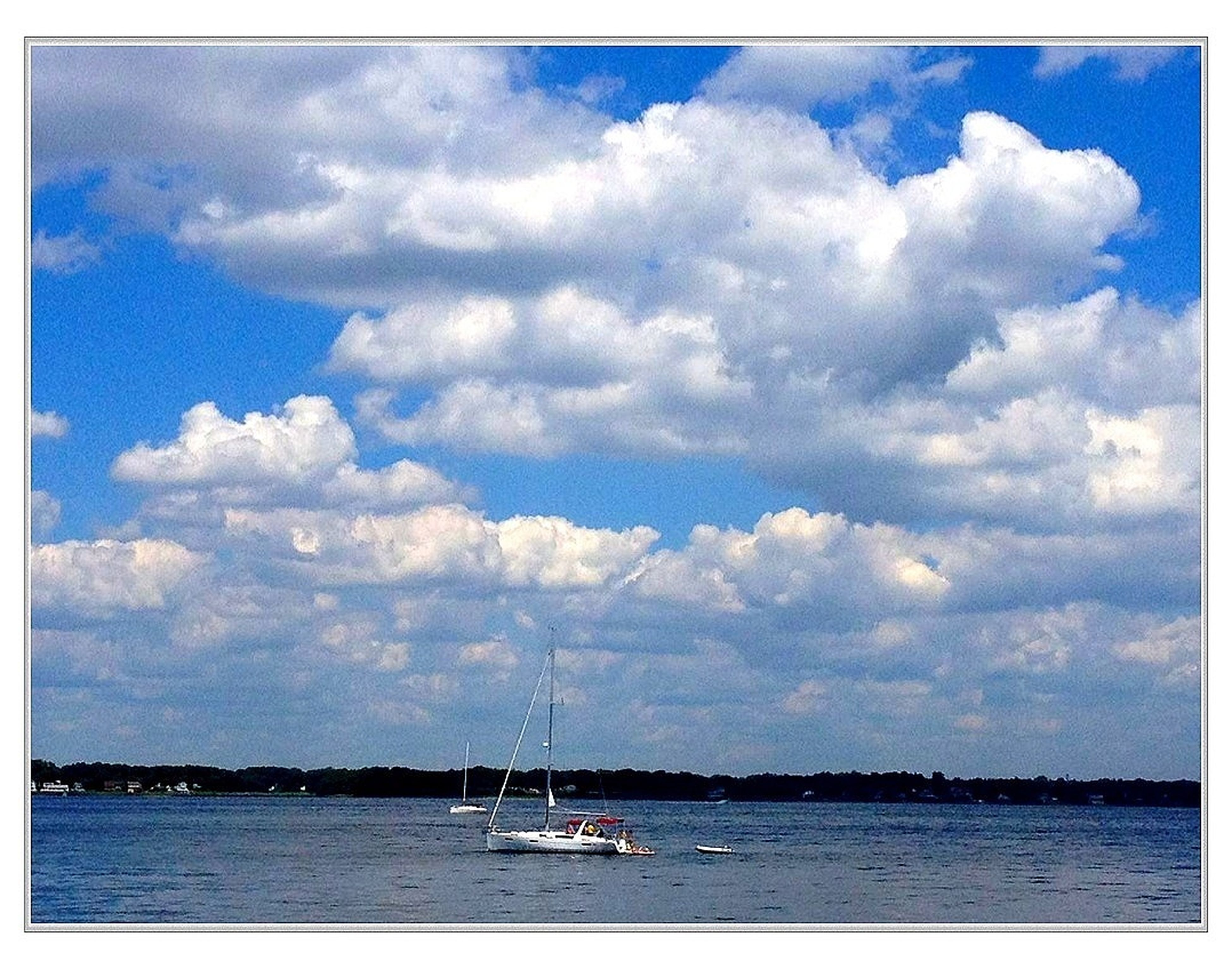 nautical vessel, transportation, mode of transport, sky, water, boat, sea, waterfront, cloud - sky, sailboat, cloudy, mast, cloud, sailing, blue, tranquility, nature, tranquil scene, scenics, beauty in nature