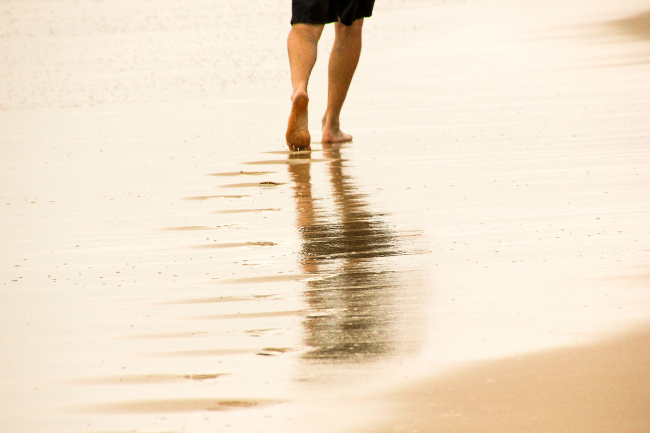 beach, sand, low section, human leg, wet, reflection, walking, real people, human body part, motion, water, vacations, one person, men, nature, sea, outdoors, day, close-up, people