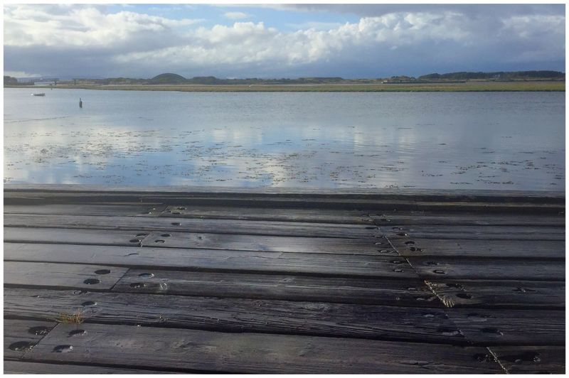Second in series - Sun shower had just soaked harbour boards Water Scenics Tranquility Tranquil Scene Reflection Nature Cloud Sky Weathered Wood Wood - Material Wooden Eyem Gallery Eyemphotography EyeEm Gallery EyeEm Eye4photography  Eyeemphotography