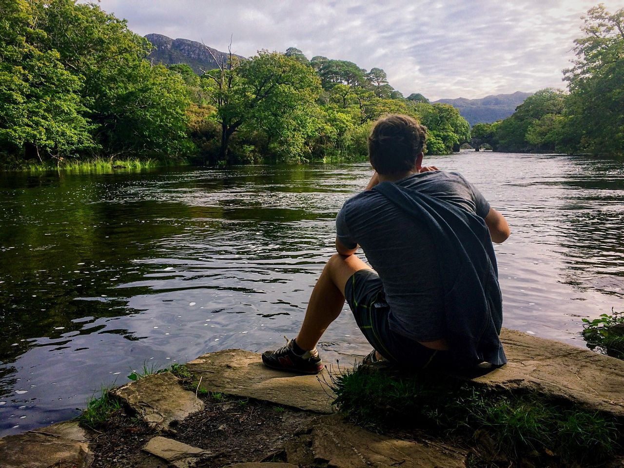 Ireland Killarney  Cill Airne Lake Rear View Sitting Water Nature Full Length Tree One Person Outdoors Stream - Flowing Water Landscape People Beauty In Nature Day Sky What Who Where