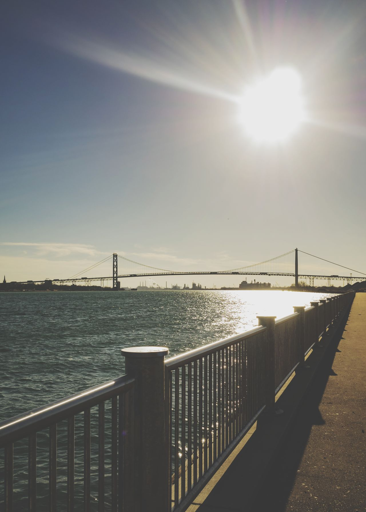 Railing Bridge - Man Made Structure Water Sunlight Sun Sea Outdoors Horizon Over Water Nature Beauty In Nature Day No People Sky Detroit