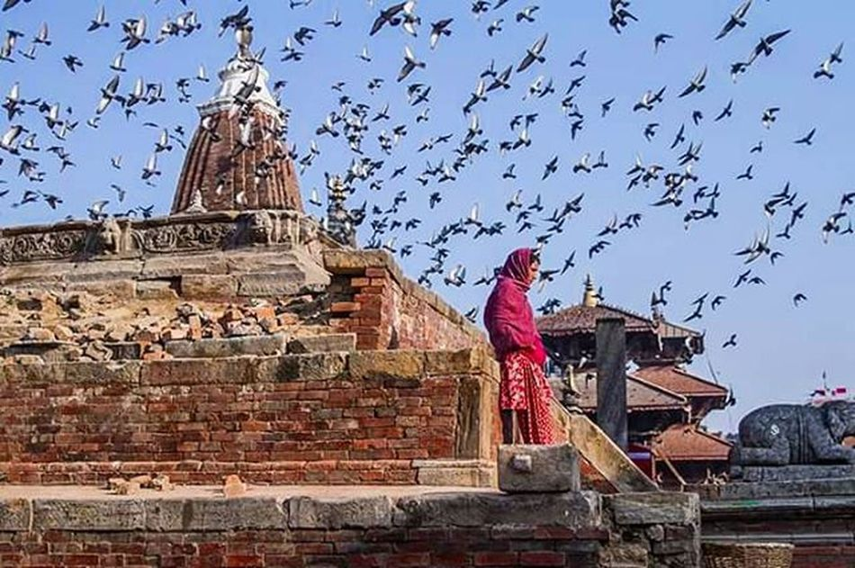 Lady in red.. Nepalphotoproject Nepal Patandurbarsquare Patan Colorsofnepal Hamrophotos Natgeo