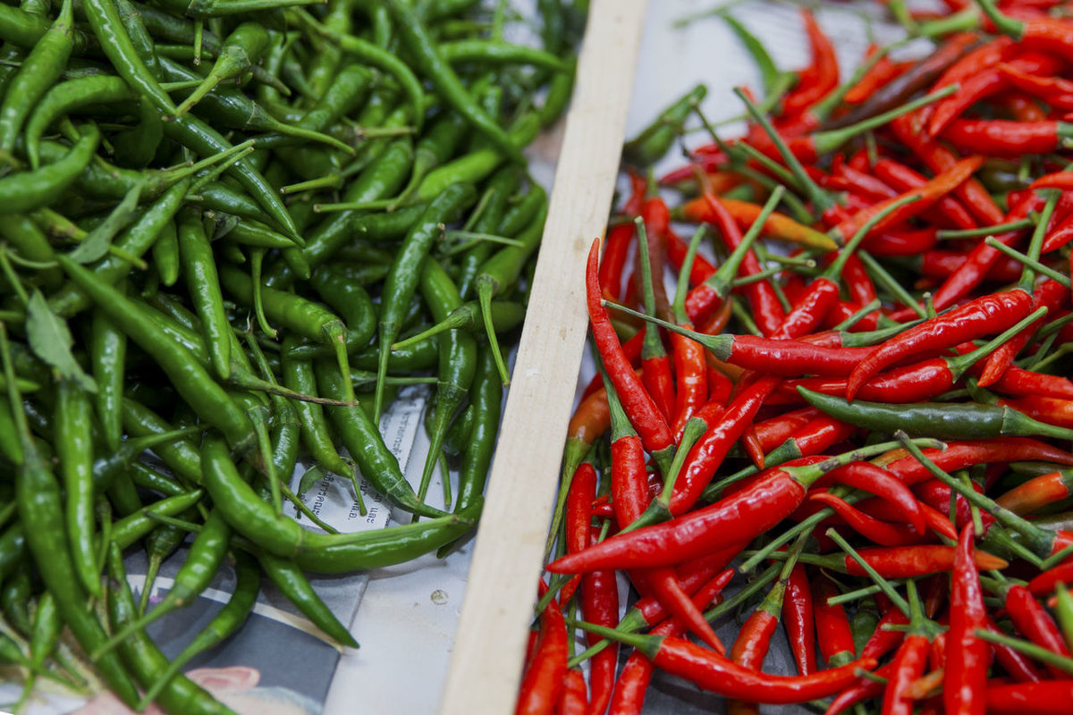 Thai food spicy Chemical Free Chilli Clean Food Food And Drink For Sale Fresh Freshness Healthy Healthy Eating High Angle View Market No People Peppers Raw Food Raw Materials Red Red Chili Pepper Refreshing Retail  Sour Spice Spicy Food Tomatoes Vegetable