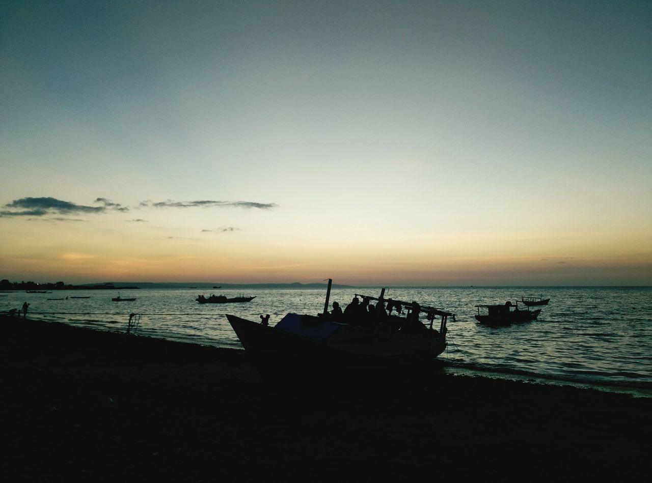 sunset, sea, nautical vessel, water, beauty in nature, nature, transportation, horizon over water, boat, scenics, mode of transport, beach, sky, moored, silhouette, tranquility, shore, longtail boat, tranquil scene, outdoors, cloud - sky, no people, outrigger, jet boat
