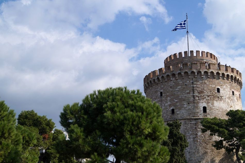white tower Architecture Building Exterior Built Structure Castle Cloud Cloud - Sky Cloudy Culture Dusk Famous Place Historic History No People Outdoors Overcast Port Of Thessaloniki Religion Sky Thessaolini Town Tree White Tower Of Thessaloniki