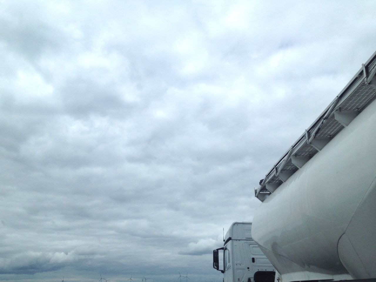 Truck Against Cloudy Sky