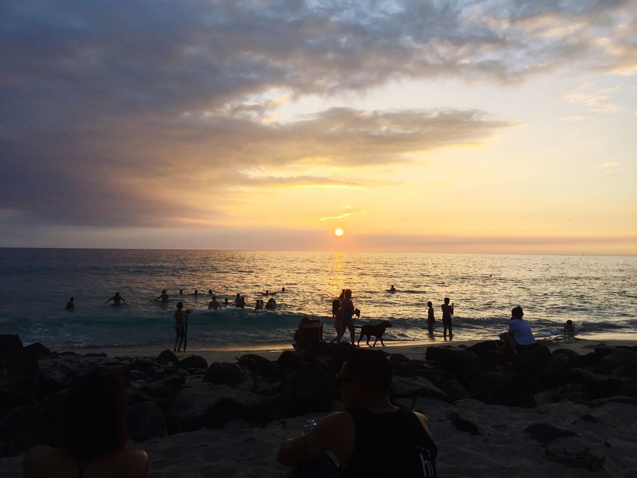 Sea Beach Sunset Water Horizon Over Water Sky Lifestyles Leisure Activity Real People Beauty In Nature Shore Cloud - Sky Outdoors Large Group Of People Nature Women Rock - Object Vacations Tranquil Scene Men Vacations Travel Destinations Hawaii Playing Sand