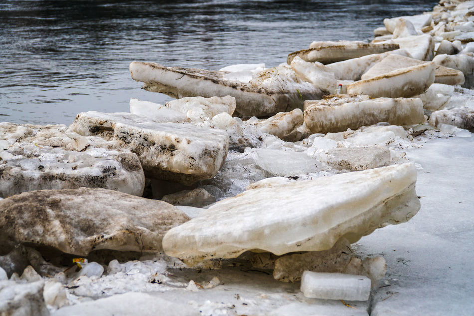 Pieces of ice in the river in spring - debacle / crushed - melting ice Bank Big Pieces Block Blocks City City Problems Crushed Debacle Embankment Ice Lake March Melt Melting Piece Quay River River Flow River View Seawall Spring Spring Has Arrived Springtime Water Winter