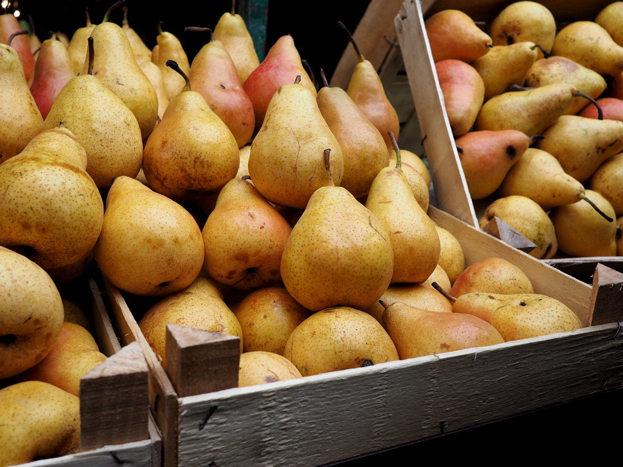 Autumn Pears for Sale Autumn Backgrounds Beautifully Organized Close-up Day Delicious Food Food And Drink For Sale Freshness Fruit Harvest Healthy Eating Imperfection Indoors  Large Group Of Objects Market No People Organic Pear Wooden Box Yellow