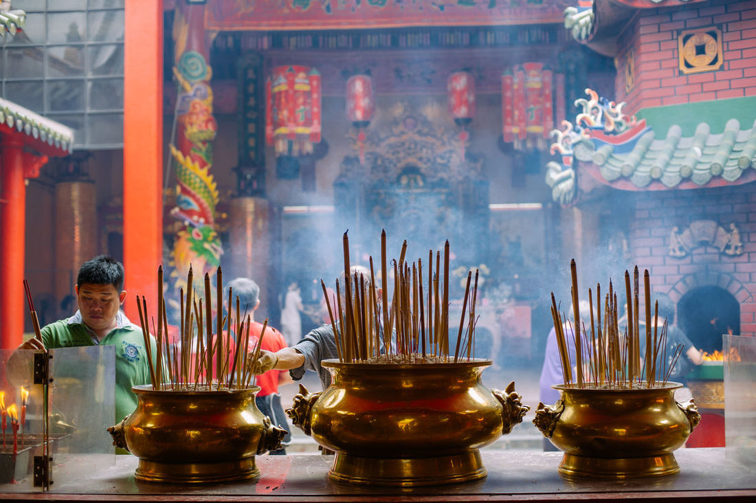Burning Candle Chinese Script Culture Cultures Decorative Urn Famous Place Flame Glowing Group Of Objects Incense Indoors  Large Group Of Objects Multi Colored Place Of Worship Religion Religious Offering Scented Smoke Smoke - Physical Structure Spirituality Temple - Building Tradition Travel Destinations Variation The Photojournalist - 2017 EyeEm Awards