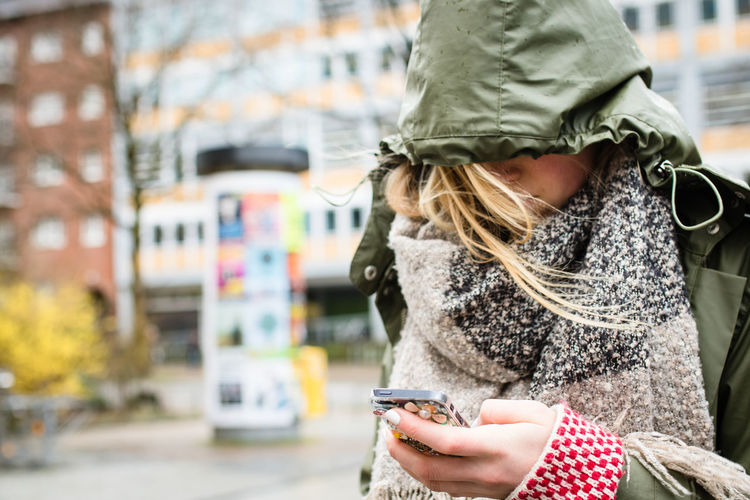 Autumn Bad Weather City Connection Covered Bridge Face Focus On Foreground Germany Hamburg Internet Internet Addiction One Person Outdoors Rain Rainy Days Smartphone Standing Storm Stormy Weather Warm Clothing Windy Wireless Technology Young Woman