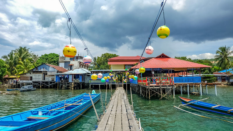 Wooden floating house/structures decorated with lanterns in Ambon, Maluku Ambon AmbonIsland Wooden Boat Architecture Boat Boats Building Exterior Built Structure Cloud - Sky Day Floating House Floating On Water Maluku  Mode Of Transport Moluccas Multi Colored Nature Nautical Vessel No People Outdoors Sky Transportation Tree Water Wooden House