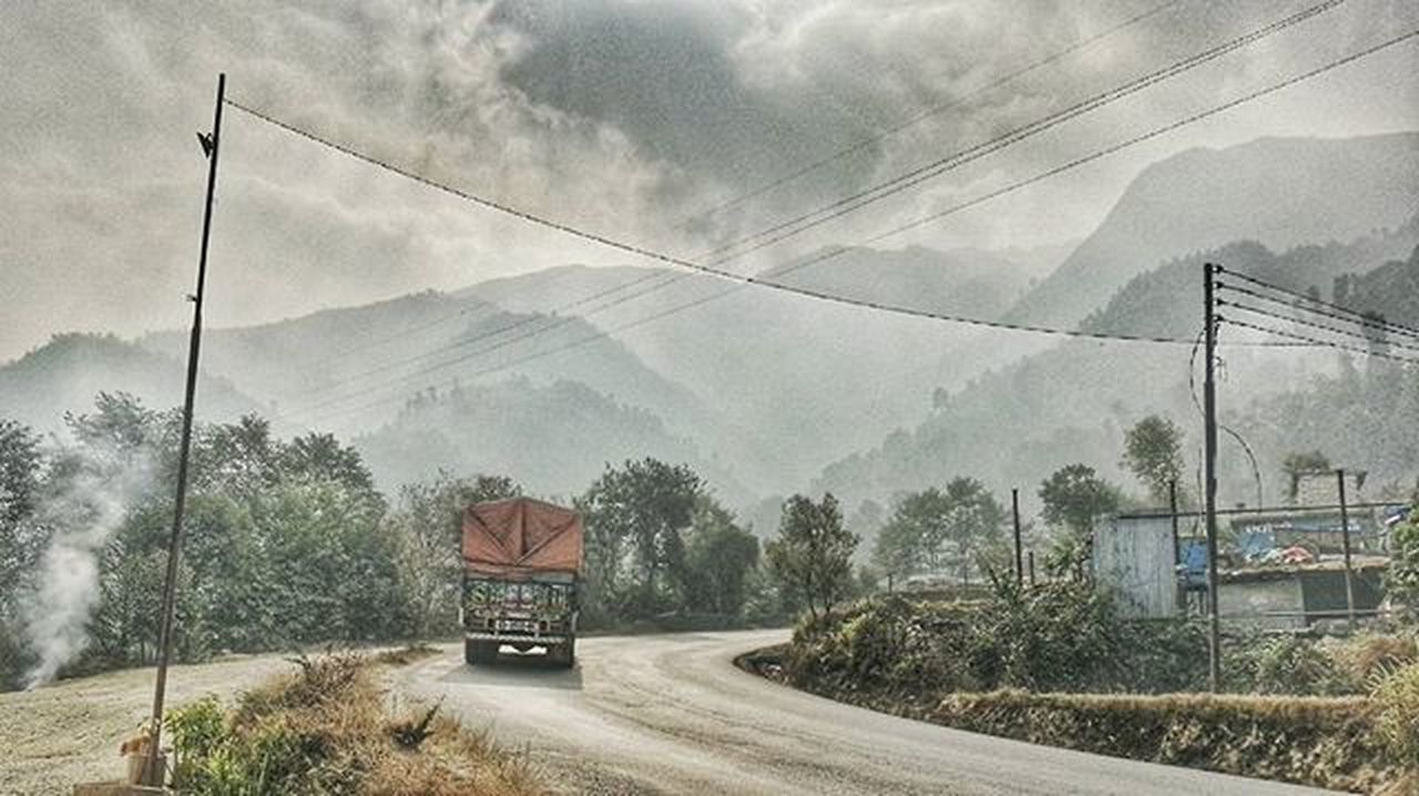 On the way to Pokhara! Highway Traveldiaries Hillroad Cloudporn Foggyroad Eyeemnepal Mobilephotography Trucks Landscape Grainy HDR Hdroftheday