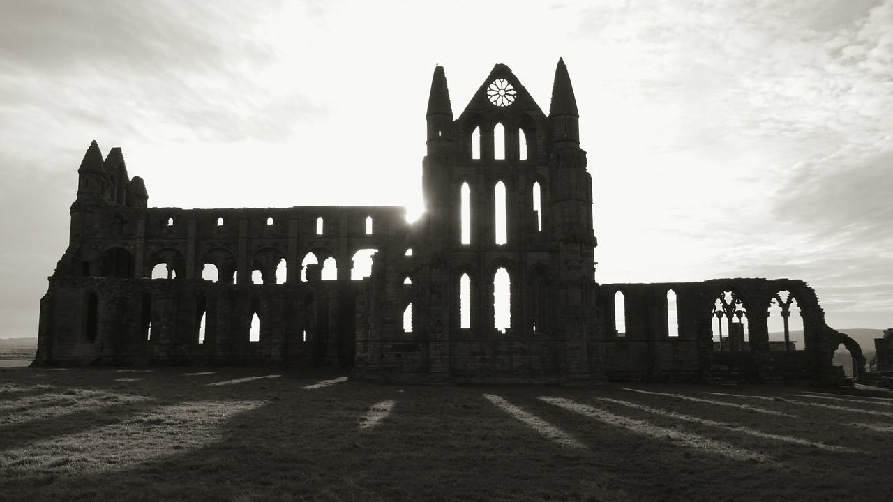 History Spooky Atmosphere Ancient Architecture 657 A.d. Distant Sea Magnificent No People Building Exterior Whitby Abbey Silhouette Sun In Background Architecture Travel Destinations Outdoors Cloud - Sky Grass Built Structure Ruin Building Silhouette Architecture Henry VIII Dissolution Of The Church Cultures