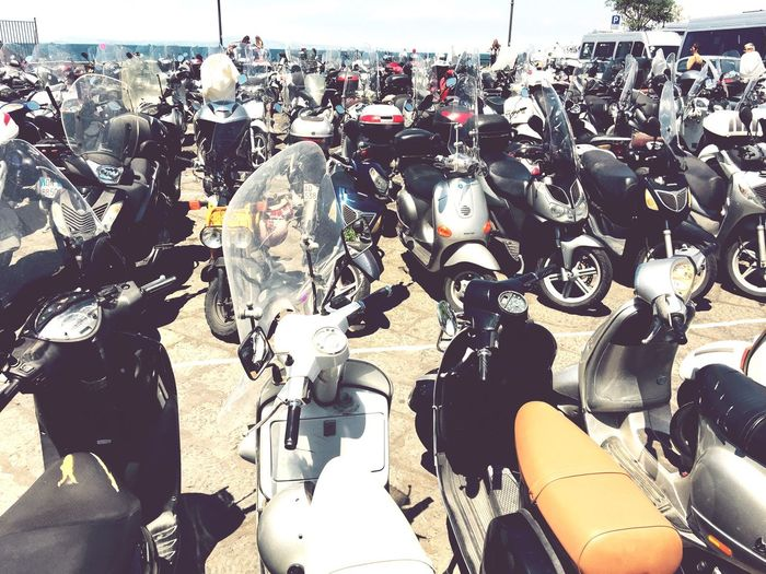 Transportation In A Row Travel Destinations Abundance Outdoors Parked Large Group Of Objects Motorcycles Vespa Spirit Of Italy