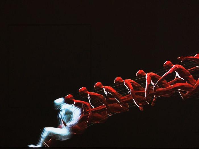 21_21 Desing Sight Athlete Red Illuminated Black Background
