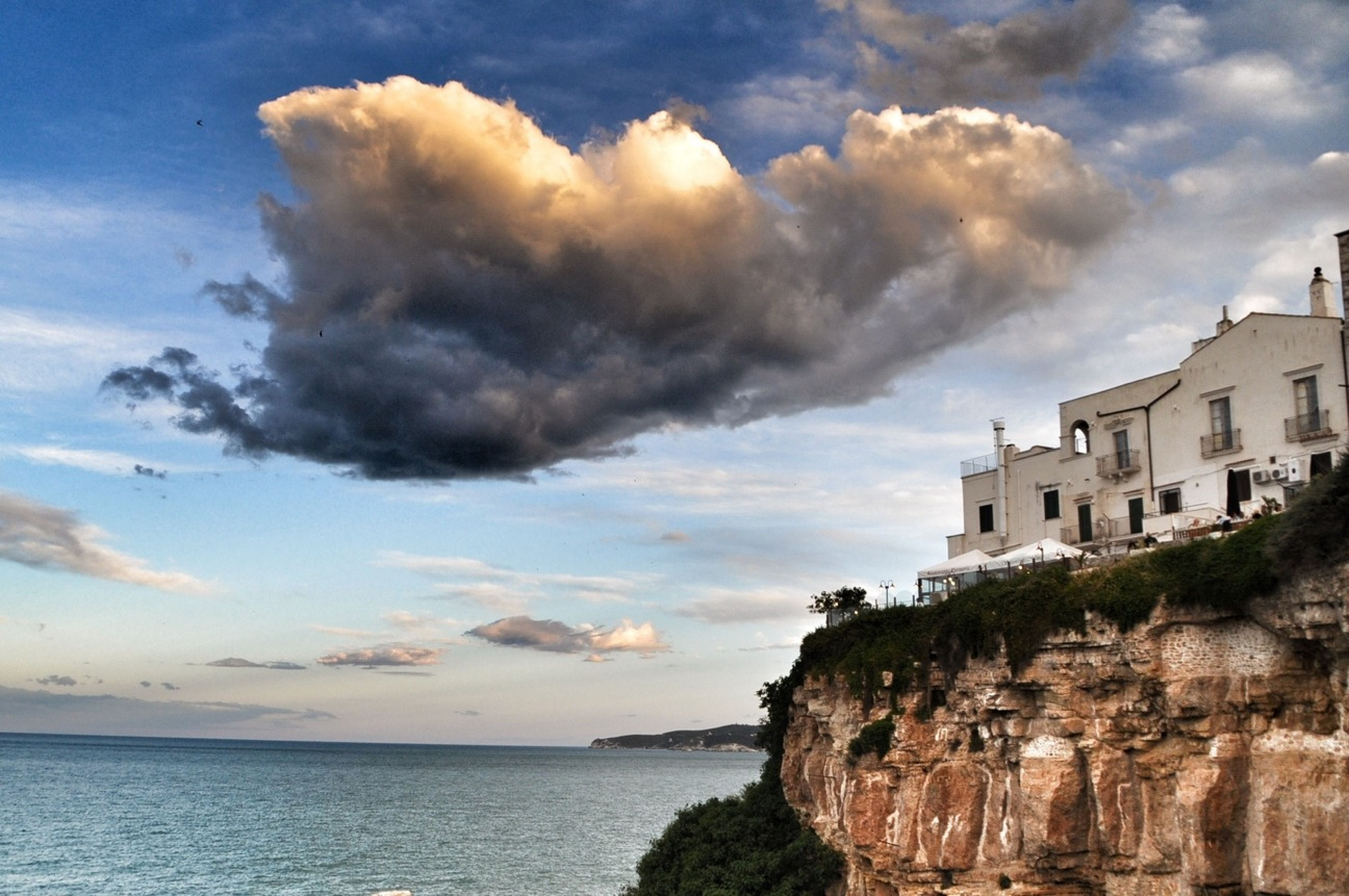 sky, sea, water, cloud - sky, scenics, rock - object, cloudy, cloud, beauty in nature, tranquil scene, building exterior, built structure, horizon over water, tranquility, architecture, nature, rock formation, rock, idyllic, cliff