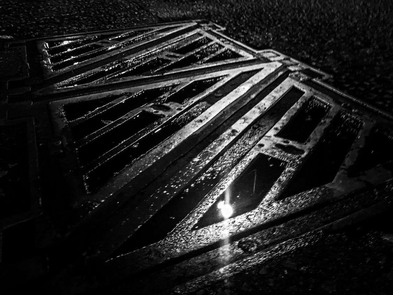 Creative Photography Streetphotography Drain Cover Dark Metallic Artistic Showcase July The Week Of Eyeem Urban Exploration Fine Art Black And White Tarmac Weathered