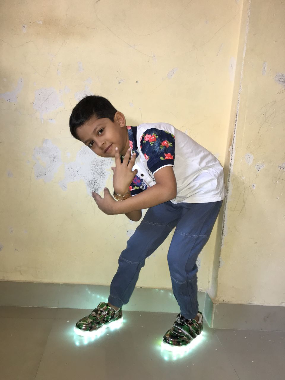 full length, casual clothing, one person, childhood, looking at camera, standing, elementary age, indoors, real people, portrait, leisure activity, playing, lifestyles, happiness, boys, smiling, day, young adult, people