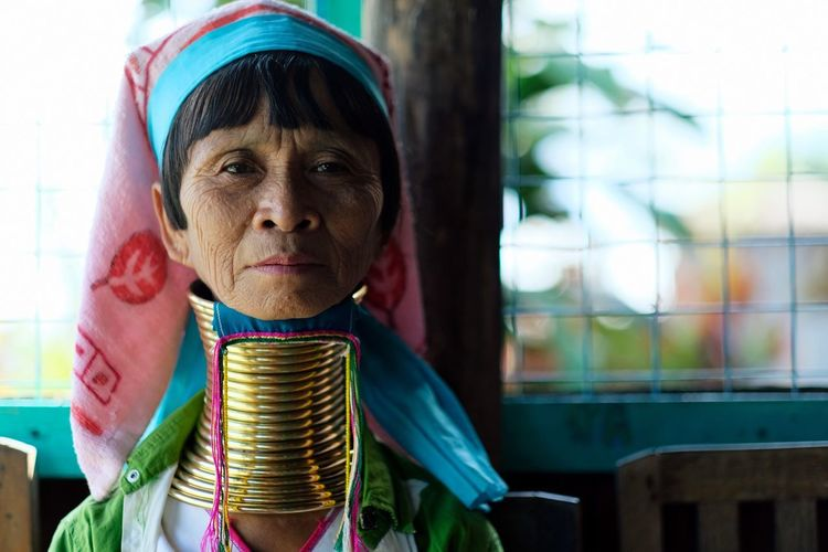Looking At Camera Headshot Portrait One Person Adult Indoors  People Close-up Day Woman Tradition Traditional Clothing Cultures Long Neck  Long Neck Tribe Rings Gold EyeEm Gallery EyeEm Best Shots Check This Out Popular Photos Jewellery in Inle Lake , Myanmar MISSIONS: The Portraitist - 2017 EyeEm Awards