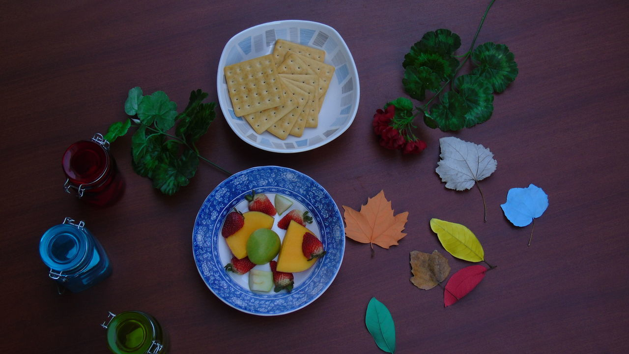 table, food and drink, indoors, high angle view, food, no people, leaf, plate, freshness, fruit, healthy eating, multi colored, ready-to-eat, close-up, day