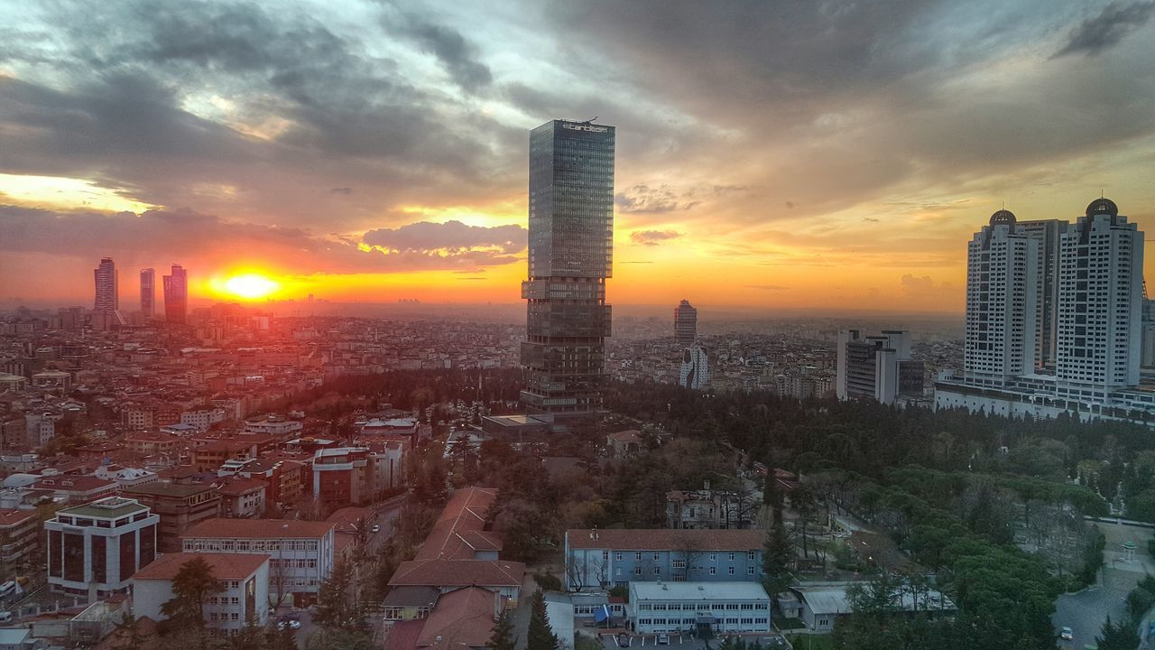 architecture, building exterior, built structure, skyscraper, city, cityscape, sunset, tower, modern, travel destinations, sky, skyline, no people, tall, urban skyline, outdoors, cloud - sky, downtown district, nature, day