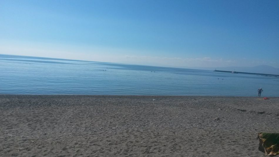 Beach Beauty In Nature Blue Coastline Day Horizon Over Water Idyllic Leisure Activity Lifestyles Nature Non-urban Scene Outdoors Remote Scenics Sea Seascape Shore Sky Tourism Tranquil Scene Tranquility Unrecognizable Person Vacations Water
