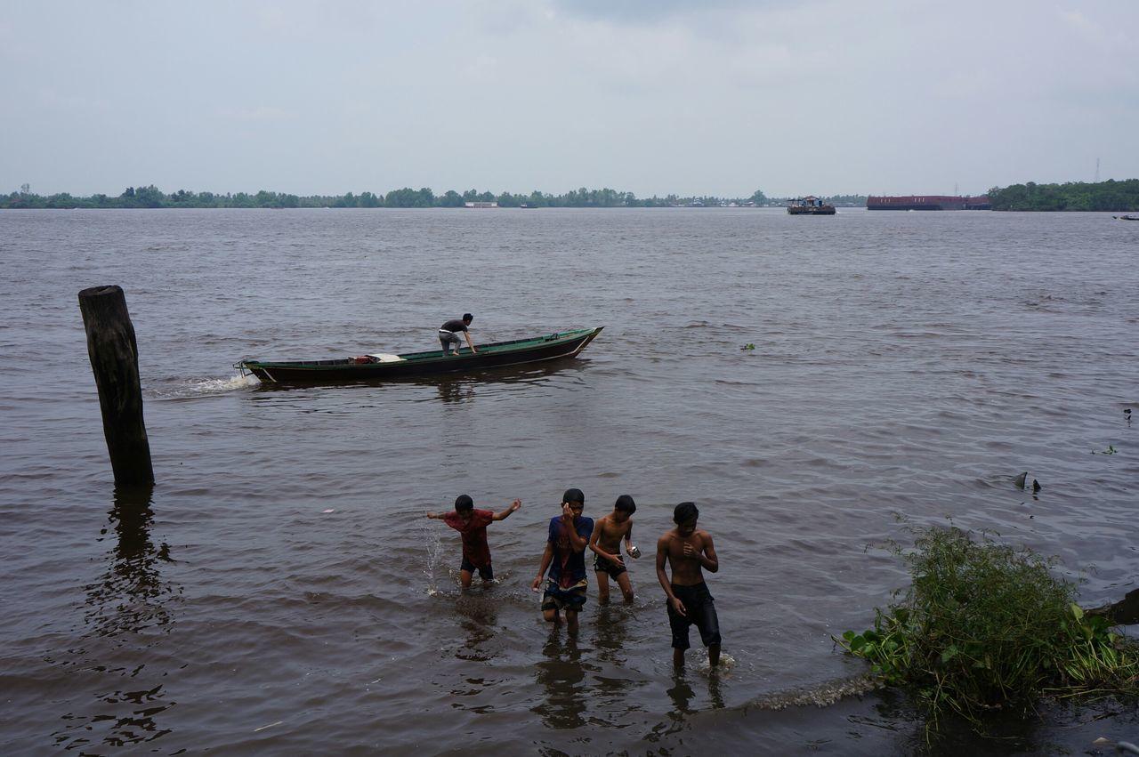 water, sky, real people, day, outdoors, men, teamwork, nature, sea, nautical vessel, people