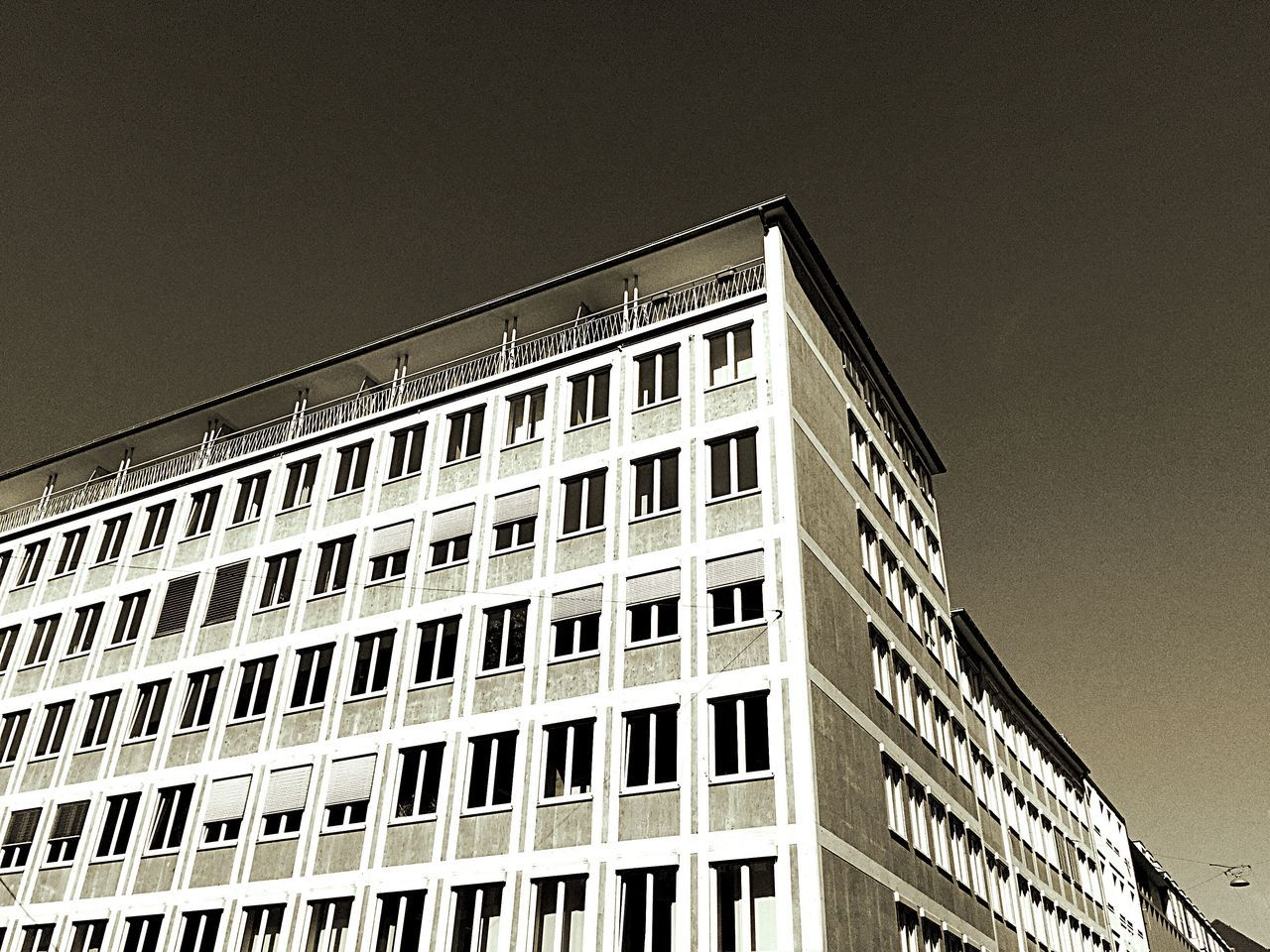 architecture, built structure, building exterior, low angle view, window, no people, outdoors, day, modern, sky, clear sky, city