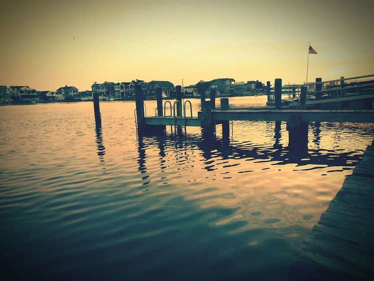 Stone harbor Water Reflection Outdoors Sky Sunset Lake No People Cloud - Sky Scenics Tranquility Nature Beauty In Nature Day City
