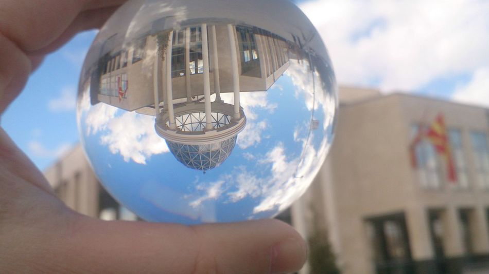 Veles Macedonia Theatre Holding Sphere Human Hand Reflection Sky Planet - Space Outdoors Building Exterior Close-up Urban Skyline Inspiration Blue Crystal Ball Building Built Structure EyeEmNewHere