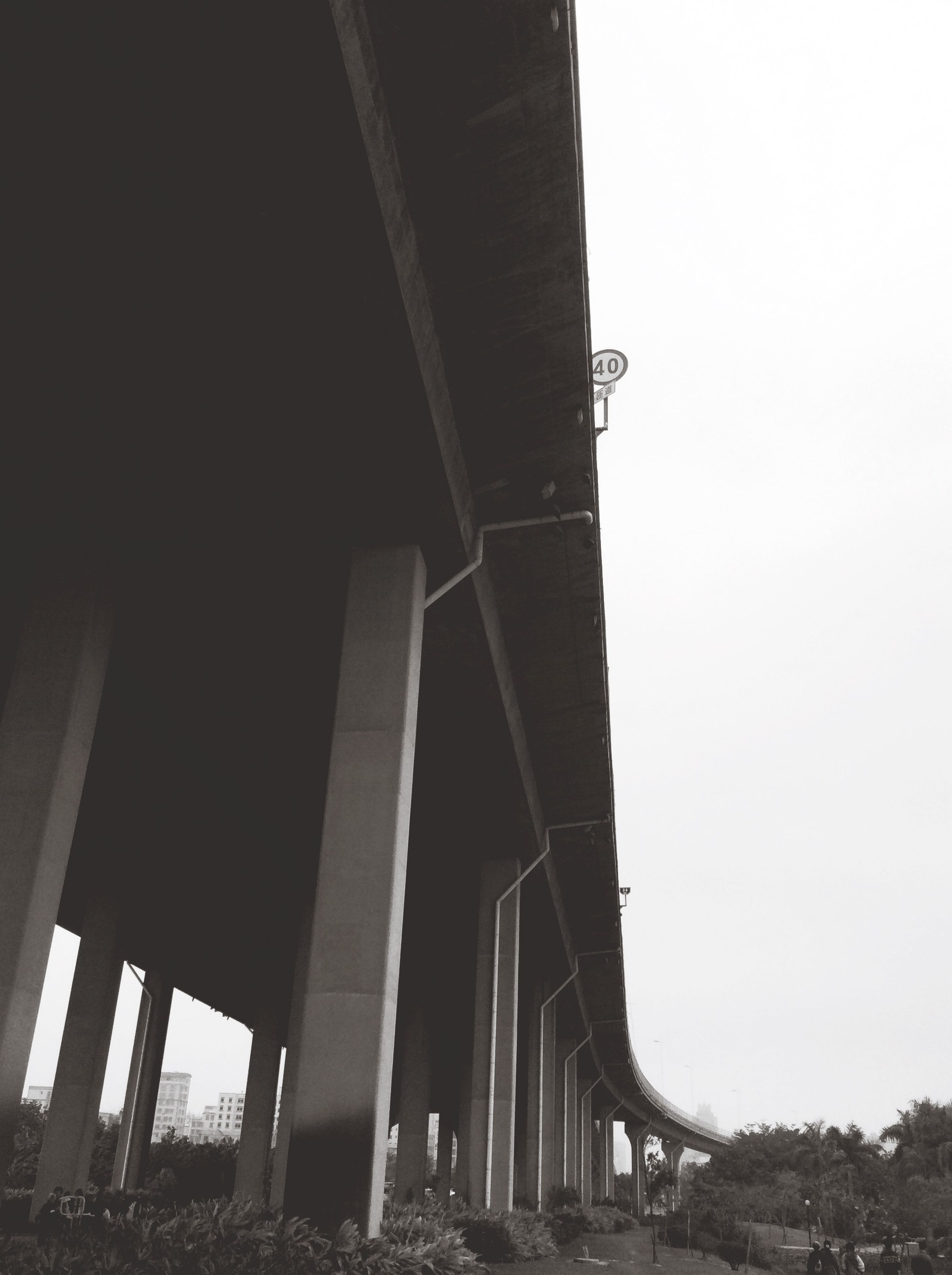 architecture, built structure, clear sky, bridge - man made structure, connection, low angle view, building exterior, copy space, transportation, engineering, bridge, architectural column, sky, outdoors, city, day, no people, arch, column, suspension bridge