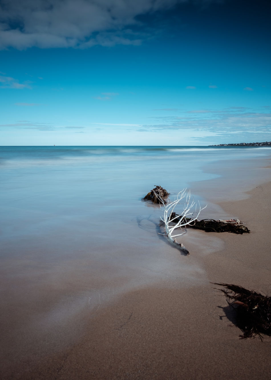 What is better than a beach walk with fresh air and just the sound of the wind and the waves.. Location: Lossiemouth, Scotland Equipment: Fujifilm X-T1 + XF18-55 Beach Beauty In Nature Blue Cloud - Sky Day Environment Fuji Fujifilm Horizon Horizon Over Water Landscape Lossiemouth Nature No People Outdoors Sand Scenics Schottland Scotland Sea Sky Water Wave Waves Wilderness