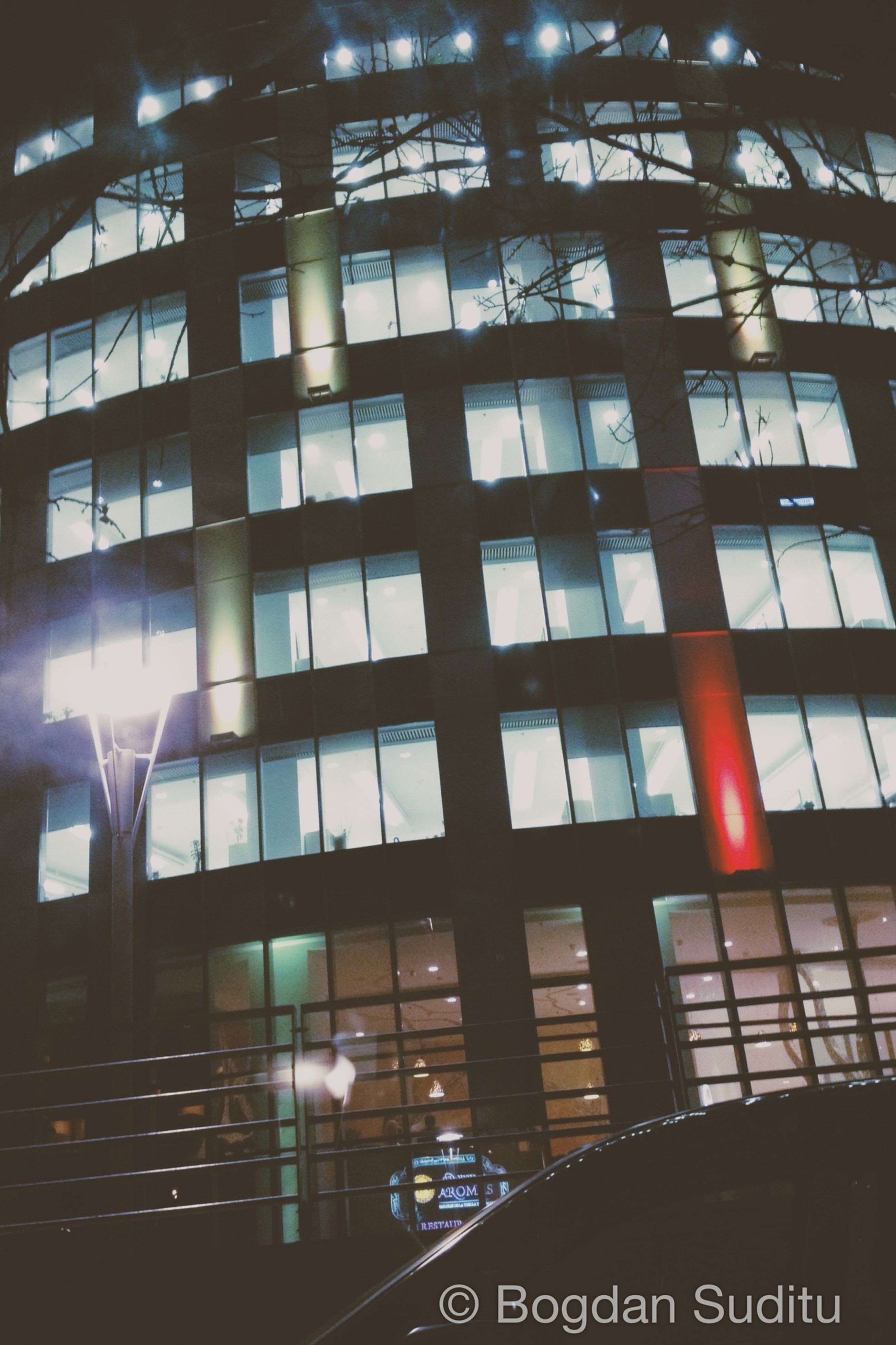architecture, built structure, illuminated, low angle view, window, building exterior, glass - material, modern, indoors, building, city, reflection, office building, night, no people, text, pattern, transparent, sunlight, architectural feature
